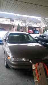 2001 Oldsmobile Intrigue with winter tires on rims