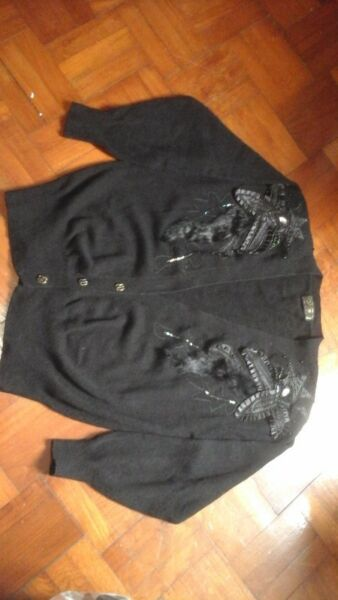 Black woollen cardigan with fine decorations