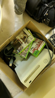 Two xbox 360 and bunch of extras