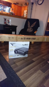 """Brand new Vector LED projector and 72"""" screen."""