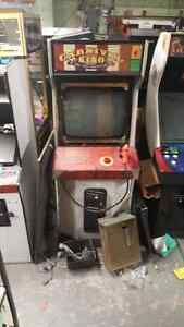 Arcade cabinet coin operated.