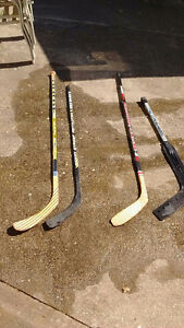 right and left handed sticks and goalie stick