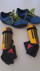 Youth soccer shoes and shin pads