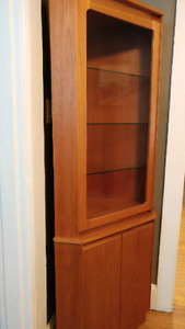 Teak corner cabinet with lighting.