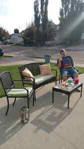 Excellent condition, weatherproof wicker patio set.