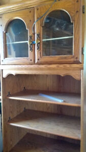 Shelving unit with glass cabinet