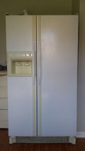 Double door refrigerator in white colour good working