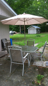 Lovely patio table, umbrella, and four chairs!  In great shape!