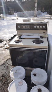 Older Electric stove in good working order. $25 obo