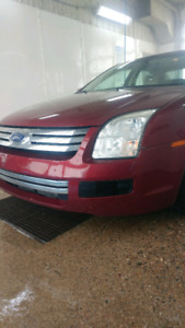 2006 ford fusion low km asking $4,000