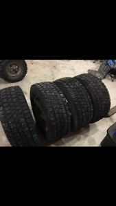 4 winter studded tires 275-65-18 on Ford F-150 rims