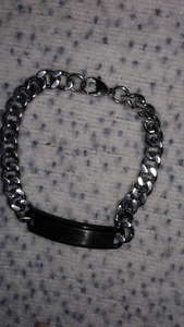 Silver bracelet with medical band on it.