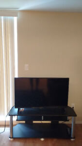 40 inch Smart TV with TV stand  less than 1 yr old