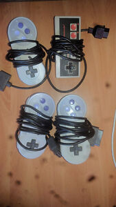 3 SNES controllers one NES controller