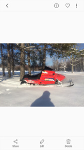 Package deal 2 snowmobiles and trailer.