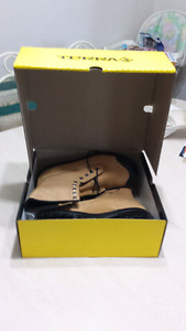 New in box , size 11 steel toed work boots.