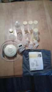 Medela swing electric breast pump with lots of extras!