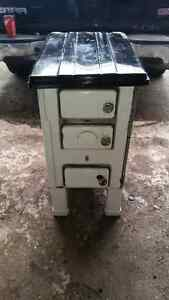 Old wood burning stove. $200 as is