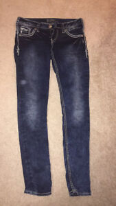 Silver Aiki faux flap skinny jeans size 27 inseam of 31