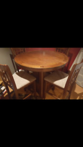 Lovely hardwood pub height dining room table with 4 chairs