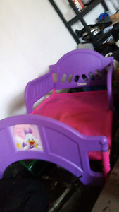 Pink and purple toddler bed