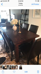 Solid teak table.  Can be used as condo table or a desk