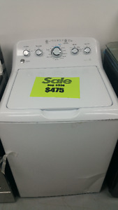 5 New GE Top load HE Washing machines. 1 New GE Dryer.