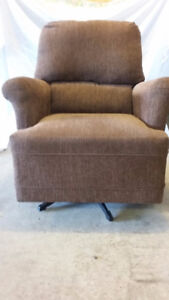 Brown swivel, rocker chair. (excellent condition).