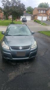2009 Suzuki SX4 Hatchback FOR SALE $3999.99  GREY COLOR