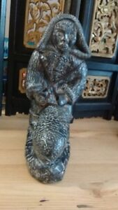 NUVUK CANADA INUIT SOAPSTONE CARVING FIGURINE MAN & BIG FISH
