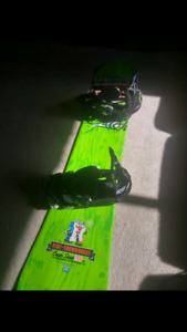Barley used Snowboard with boots and helmet 400$ obo