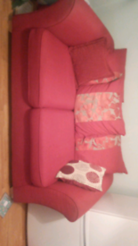 Red 2 seater with the chair and puffer