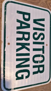 Used visitor parking lot sign