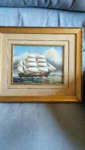 gold framed sailboat