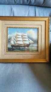 gold framed sailboat
