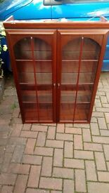 "Two very nice display cabinets. Glass paneled front doors. Price is for the ""PAIR"" not each."