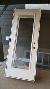 "EXTERIOR STEEL DOOR WITH GLASS AND MINI BLINDS 32"" X 80"""