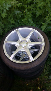 Aftermarket Alloy Rims and Tires.