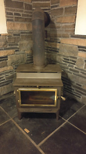Wood Stove / Fire Place Good Condition
