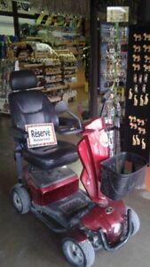 Quadriporteur (chaise roulante motorisée)