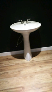 Pedestal sink with faucet. Good condition