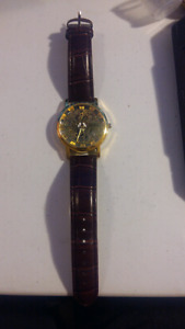 gold see through watch with leather straps