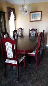 Table and 8 padded chairs for sale