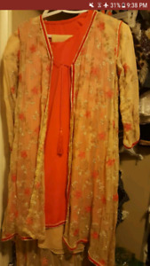 Embroidered  tail dress in peach and skin colour