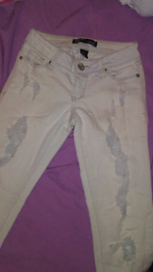 Ladies white ripped jeans