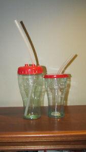 Two Coca-Cola Green Tinted Plastic Cups with Lids & Straws