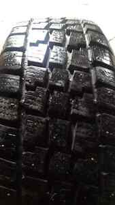 Studded winter tires on rims. Like new! 1000.00 ONO