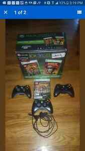 Xbox 360 Elite in box with controllers