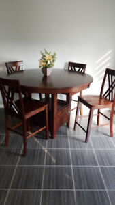 Bar style high top round table with 6 chairs