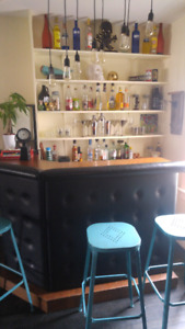 Bar with 4 bar stools and supplies